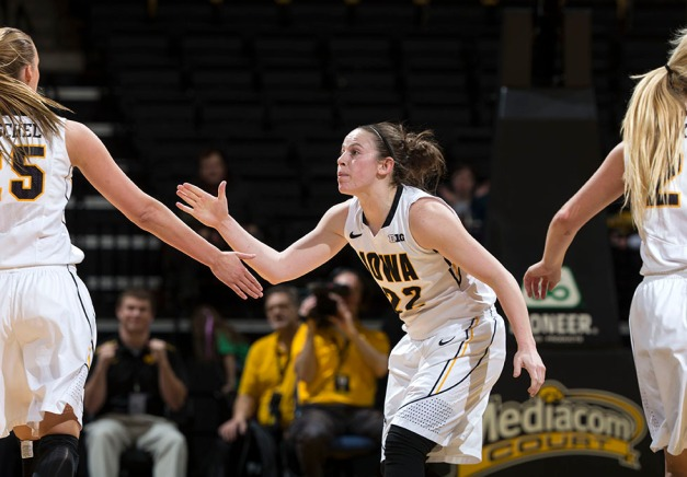 Iowa Hawkeyes guard Samantha Logic (22) slaps hands with forward Kali Peschel (25) during the first half of their game against the Ohio State Buckeyes Thursday, Feb. 5, 2015 at Carver-Hawkeye Arena in Iowa City.  (Brian Ray/hawkeyesports.com)