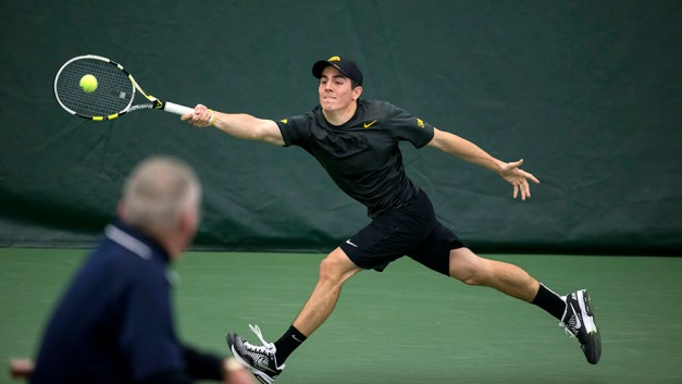 Iowa's Dominic Patrick plays a shot during their match against  Marquette Friday, Feb. 6, 2015 at the Hawkeye Tennis and Recreation Center.  (Brian Ray/hawkeyesports.com)