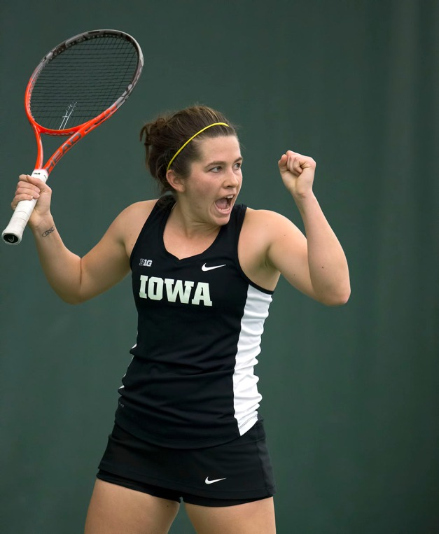 Iowa's Shelby Talcott celebrates a point during their match against  Iowa State Friday, Feb. 6, 2015 at the Hawkeye Tennis and Recreation Center.  (Brian Ray/hawkeyesports.com)