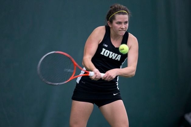 Iowa's Shelby Talcott plays a shot during their match against  Iowa State Friday, Feb. 6, 2015 at the Hawkeye Tennis and Recreation Center.  (Brian Ray/hawkeyesports.com)