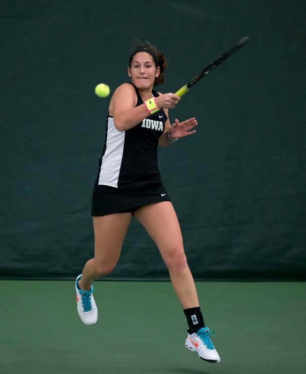 Iowa's Ellen Silver plays a shot during their match against  Iowa State Friday, Feb. 6, 2015 at the Hawkeye Tennis and Recreation Center.  (Brian Ray/hawkeyesports.com)