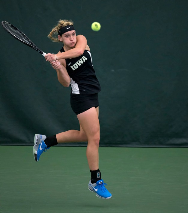 Iowa's Annette Dohanics plays a shot during their match against  Iowa State Friday, Feb. 6, 2015 at the Hawkeye Tennis and Recreation Center.  (Brian Ray/hawkeyesports.com)