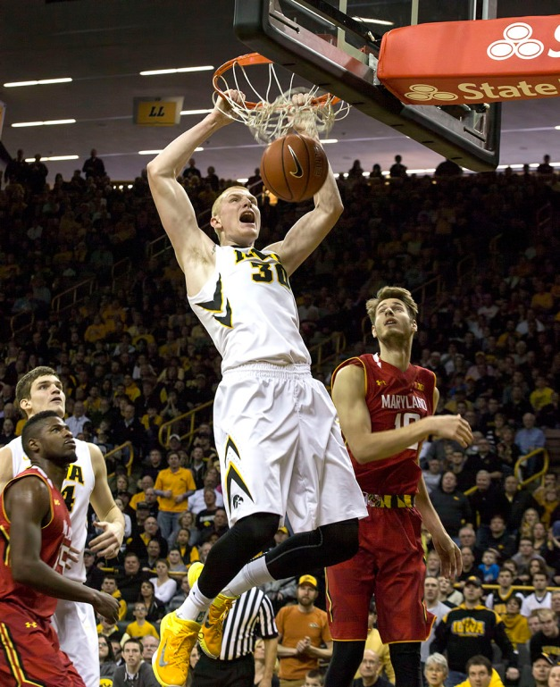 Iowa Hawkeyes forward Aaron White (30) dunks the ball over Maryland Terrapins guard/forward Jake Layman (10) during the first half of their game Sunday, Feb. 8, 2015 at Carver-Hawkeye Arena.  (Brian Ray/hawkeyesports.com)