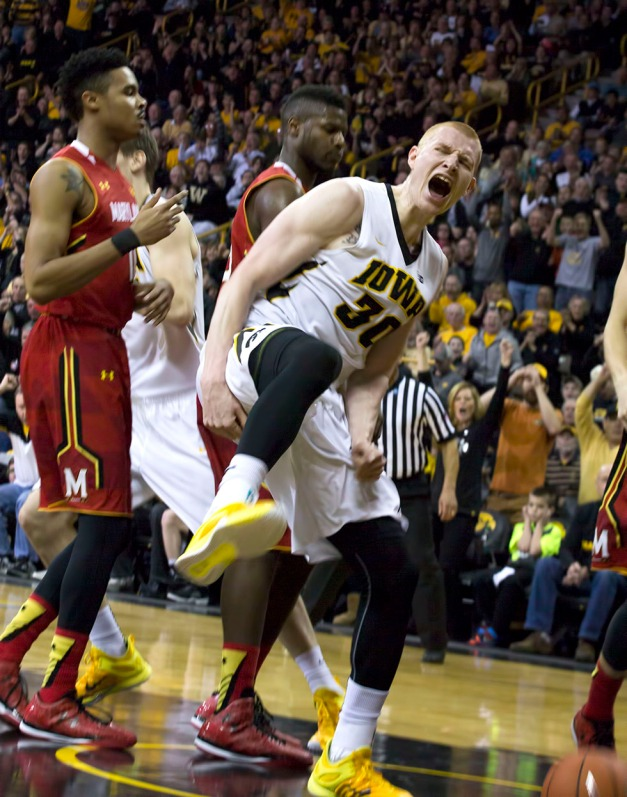 Iowa Hawkeyes forward Aaron White (30) reacts after dunking the ball over Maryland Terrapins guard/forward Jake Layman (10) during the first half of their game Sunday, Feb. 8, 2015 at Carver-Hawkeye Arena.  (Brian Ray/hawkeyesports.com)