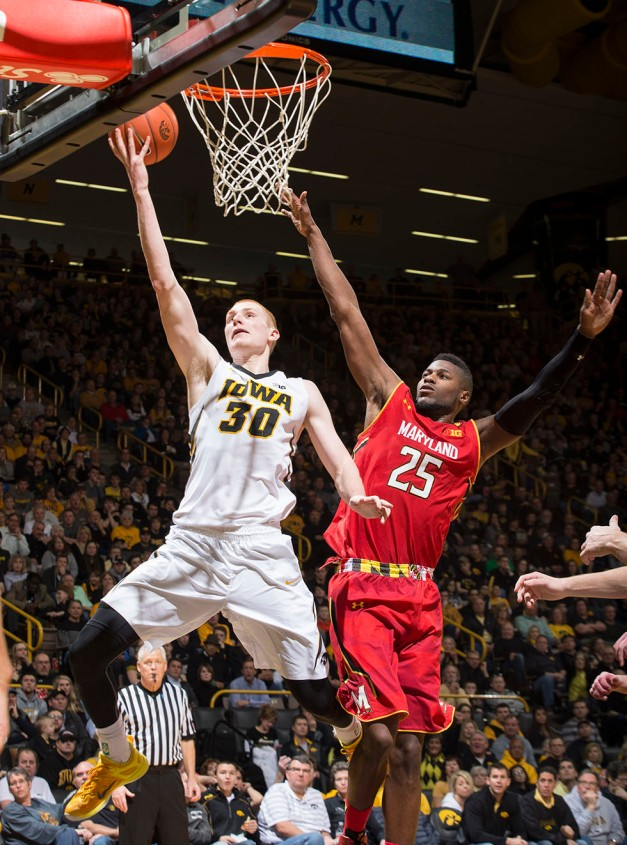 Iowa Hawkeyes forward Aaron White (30) goes to the hoop past Maryland Terrapins forward Jonathan Graham (25) during the second half of their game Sunday, Feb. 8, 2015 at Carver-Hawkeye Arena.  (Brian Ray/hawkeyesports.com)
