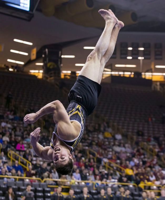 Iowa's Matt Loochtan competes on the floor during their meet against Minnesota and Nebraska Saturday, Jan. 24, 2015 at Carver-Hawkeye Arena.  (Brian Ray/hawkeyesports.com)