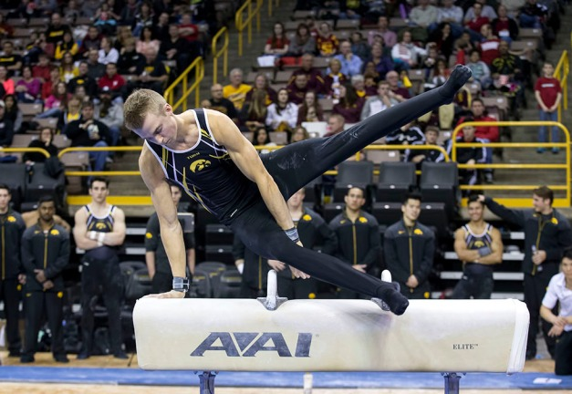 Iowa's Doug Sullivan competes on the pommel horse during their meet against Minnesota and Nebraska Saturday, Jan. 24, 2015 at Carver-Hawkeye Arena.  (Brian Ray/hawkeyesports.com)