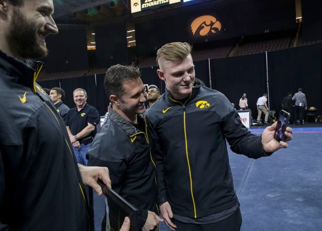 Senior Brandon Field shows head coach JD Reive his parents on FaceTime from New Zealand during senior night activities following their meet against Minnesota and Nebraska Saturday, Jan. 24, 2015 at Carver-Hawkeye Arena.  (Brian Ray/hawkeyesports.com)