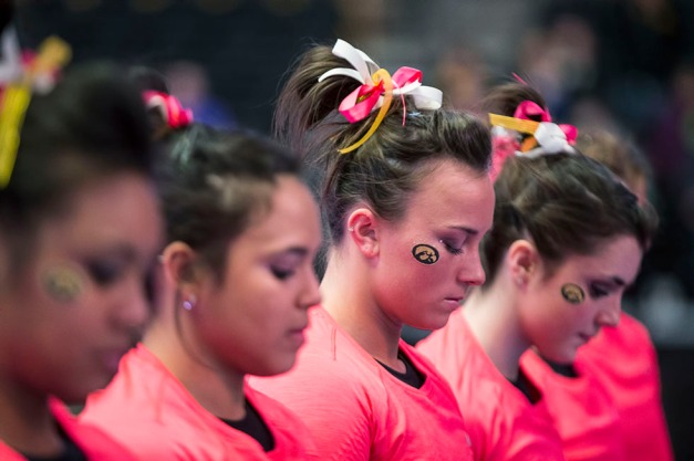 The Iowa Hawkeyes wore three different ribbons in their hair in support to of breast cancer, child hood cancer, and lung cancer during their meet against Illinois Saturday, Jan. 24, 2015 at Carver-Hawkeye Arena.  (Brian Ray/hawkeyesports.com)