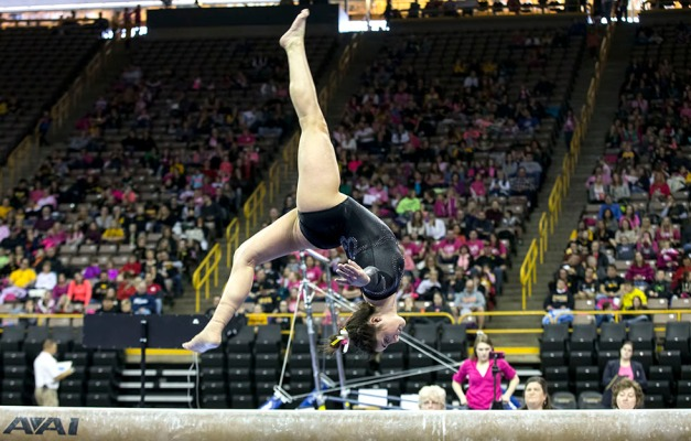 Iowa's Nikki Youd competes on the beam during their meet against Illinois Saturday, Jan. 24, 2015 at Carver-Hawkeye Arena.  (Brian Ray/hawkeyesports.com)