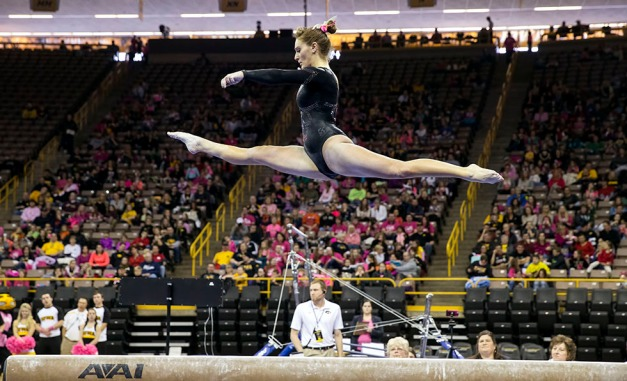 Iowa's Angel Metcalf competes on the beam during their meet against Illinois Saturday, Jan. 24, 2015 at Carver-Hawkeye Arena.  (Brian Ray/hawkeyesports.com)