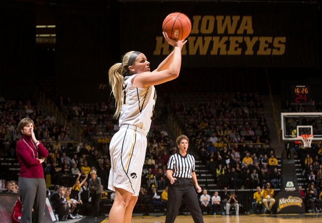 Iowa Hawkeyes guard Melissa Dixon (21) pulls up for a three point basket during the first half of their game Sunday, Feb. 15, 2015 at Carver-Hawkeye Arena in Iowa City.  (Brian Ray/hawkeyesports.com)