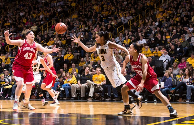Iowa Hawkeyes forward Claire Till (3) battles for a rebound with Indiana Hoosiers center Jenn Anderson (43) and guard Alexis Gassion (23) during the first half of their game Sunday, Feb. 15, 2015 at Carver-Hawkeye Arena in Iowa City.  (Brian Ray/hawkeyesports.com)