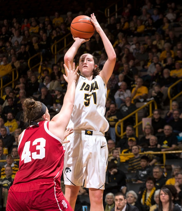 Iowa Hawkeyes center Bethany Doolittle (51) pulls up for a shot over Indiana Hoosiers center Jenn Anderson (43) during the second half of their game Sunday, Feb. 15, 2015 at Carver-Hawkeye Arena in Iowa City.  (Brian Ray/hawkeyesports.com)