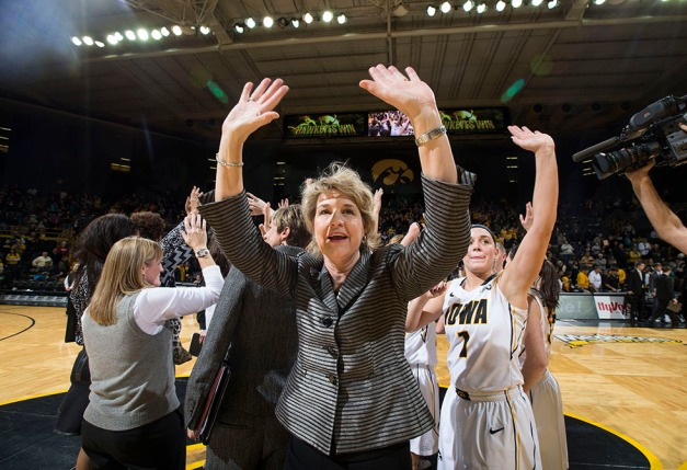 Iowa Hawkeyes head coach Lisa Bluder  celebrates their 81-64 win over the Indiana Hoosiers with her team Sunday, Feb. 15, 2015 at Carver-Hawkeye Arena in Iowa City.  (Brian Ray/hawkeyesports.com)