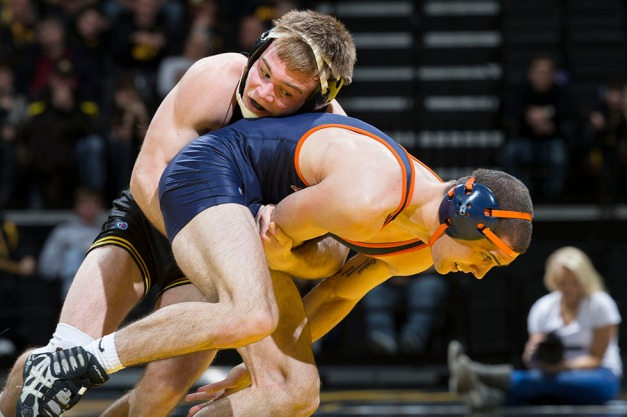 Iowa's Brandon Sorensen wrestles Virginia's Gus Sako during their 149 pound match in the opening round of the EAS/NWCA National Duals Sunday, Feb. 15, 2015 at Carver-Hawkeye Arena in Iowa City.  (Brian Ray/hawkeyesports.com)