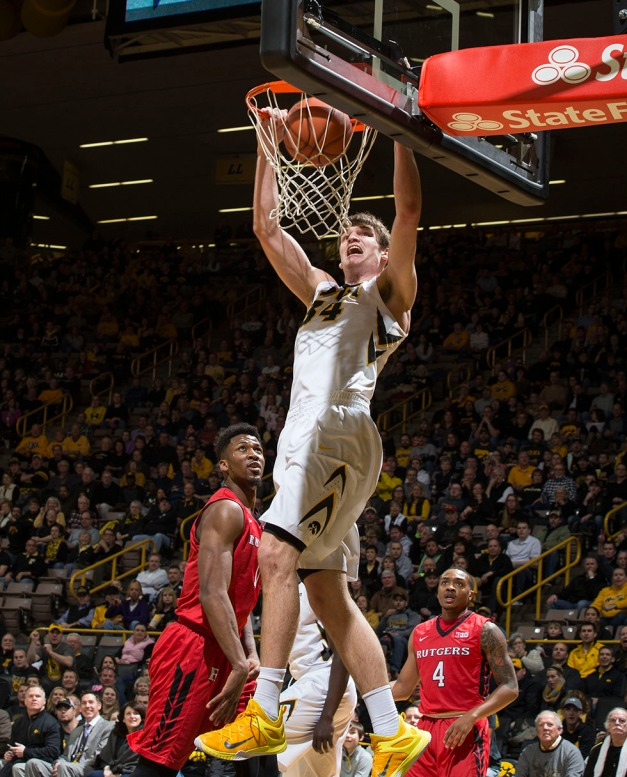 Iowa Hawkeyes center Adam Woodbury (34) dunks the ball during the first half of their game against the Rutgers Scarlet Knights Thursday, Feb. 19, 2015 at Carver-Hawkeye Arena.  (Brian Ray/hawkeyesports.com)