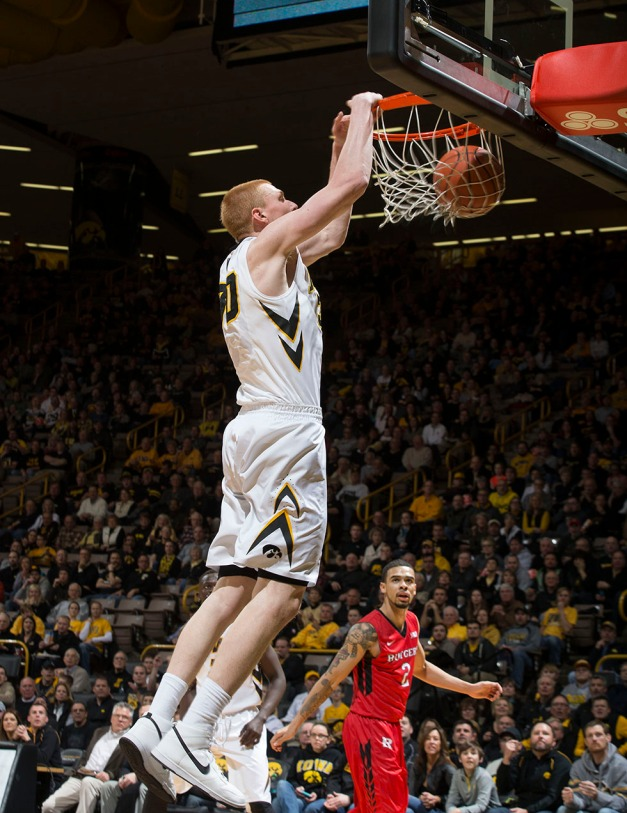 Iowa Hawkeyes forward Aaron White (30) dunks the ball during the first half of their game against the Rutgers Scarlet Knights Thursday, Feb. 19, 2015 at Carver-Hawkeye Arena.  (Brian Ray/hawkeyesports.com)