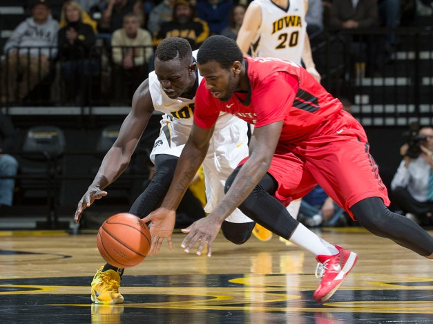 Iowa Hawkeyes guard Peter Jok (3) battles for a loose ball with Rutgers Scarlet Knights forward D.J. Foreman (22) during the first half of their game Thursday, Feb. 19, 2015 at Carver-Hawkeye Arena.  (Brian Ray/hawkeyesports.com)