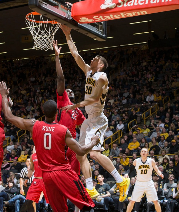 Iowa Hawkeyes forward Jarrod Uthoff (20) goes to the hoop over Rutgers Scarlet Knights forward D.J. Foreman (22) during the first half of their game Thursday, Feb. 19, 2015 at Carver-Hawkeye Arena.  (Brian Ray/hawkeyesports.com)