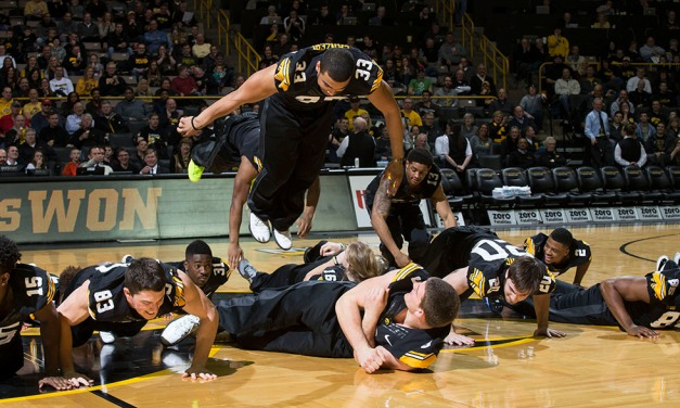 Members of the Hawkeye Football team perform at halftime of Iowa's game against the Rutgers Scarlet Knights Thursday, Feb. 19, 2015 at Carver-Hawkeye Arena.  (Brian Ray/hawkeyesports.com)