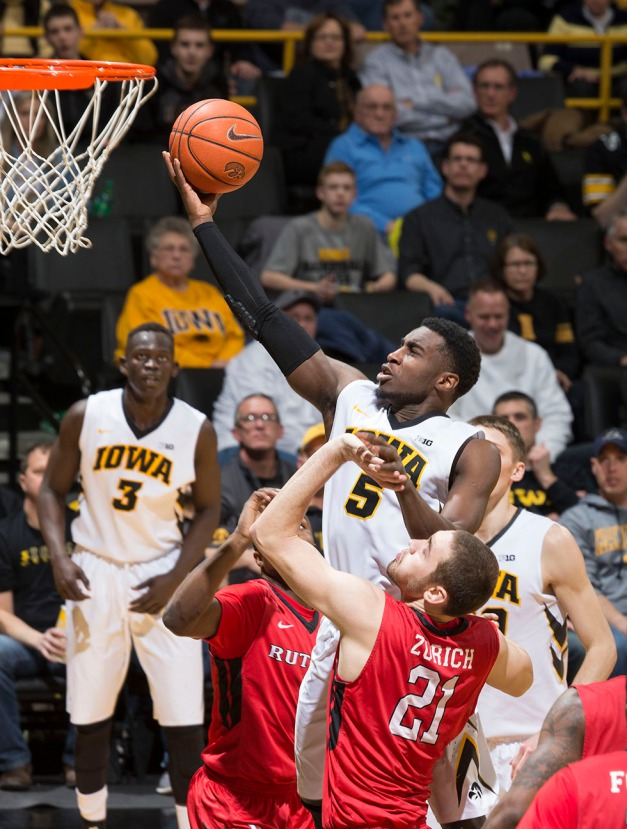 Iowa Hawkeyes guard Anthony Clemmons (5) goes to the hoop during the second half of their game against the Rutgers Scarlet Knights Thursday, Feb. 19, 2015 at Carver-Hawkeye Arena.  (Brian Ray/hawkeyesports.com)