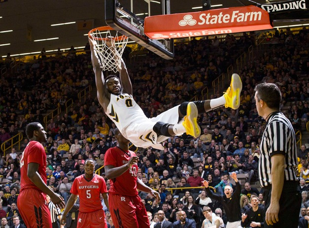 Iowa Hawkeyes center Gabriel Olaseni (0) dunks the ball over Rutgers Scarlet Knights forward D.J. Foreman (22) during the second half of their game Thursday, Feb. 19, 2015 at Carver-Hawkeye Arena.  (Brian Ray/hawkeyesports.com)