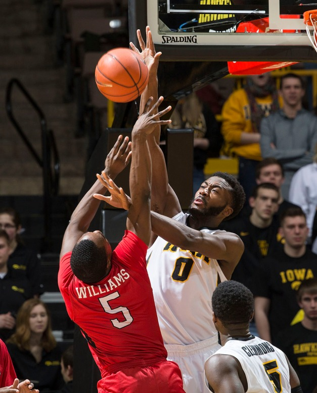 Iowa Hawkeyes center Gabriel Olaseni (0) blocks a shot by Rutgers Scarlet Knights guard Mike Williams (5) during the second half of their game Thursday, Feb. 19, 2015 at Carver-Hawkeye Arena.  (Brian Ray/hawkeyesports.com)