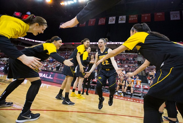 Iowa Hawkeyes guard Samantha Logic (22) is slaps her teammates hands after being introduced before their game against the Ohio State Buckeyes  Saturday, Feb. 21, 2015 at the Schottenstein Center in Columbus Ohio.  (Brian Ray/hawkeyesports.com)