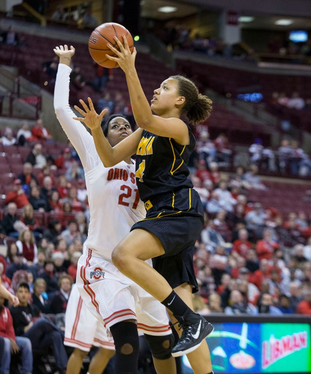 Iowa Hawkeyes forward Chase Coley (4) goes to the hoop against Ohio State Buckeyes center Lisa Blair (21) during the second half of their game Saturday, Feb. 21, 2015 at the Schottenstein Center in Columbus Ohio.  (Brian Ray/hawkeyesports.com)