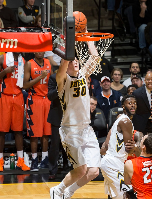 Iowa Hawkeyes forward Aaron White (30) dunks the ball during the first half of their game against the Illinois Fighting Illini Wednesday, Feb. 25, 2015 at Carver-Hawkeye Arena.  (Brian Ray/hawkeyesports.com)