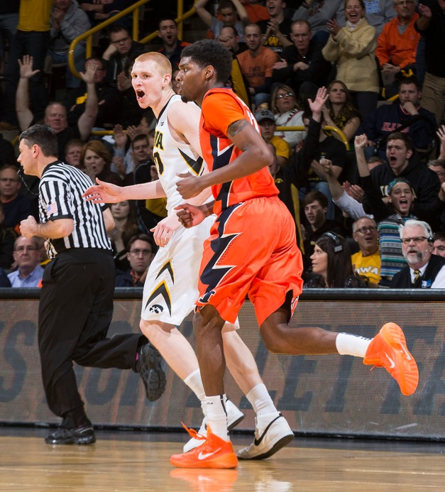 Iowa Hawkeyes forward Aaron White (30) reacts after making a three pointer during the second half of their game against the Illinois Fighting Illini Wednesday, Feb. 25, 2015 at Carver-Hawkeye Arena.  (Brian Ray/hawkeyesports.com)
