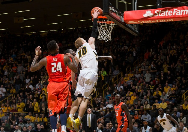 Iowa Hawkeyes guard Mike Gesell (10) dunks the ball over Illinois Fighting Illini guard Rayvonte Rice (24) during the second half of their game Wednesday, Feb. 25, 2015 at Carver-Hawkeye Arena.  (Brian Ray/hawkeyesports.com)
