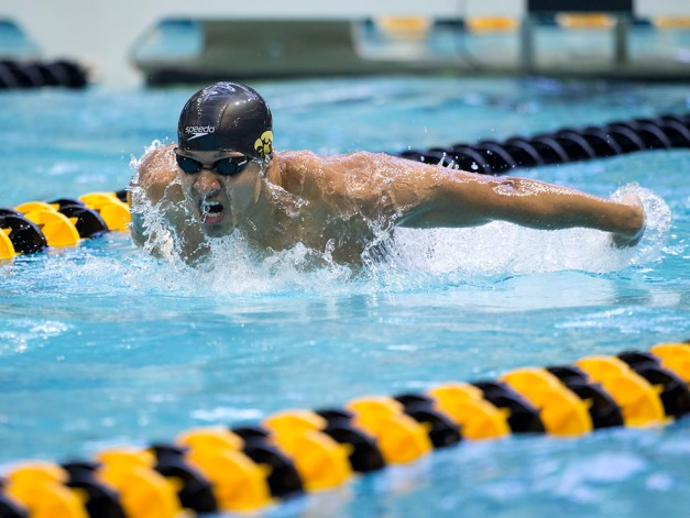 Iowa's Chuck Holliday swims in the preliminaries of the 100 yard butterfly during the fourth session of the 2015 Big Ten Men's Swimming and Diving Championships Friday, Feb. 27, 2015 at the Campus Recreation and Wellness Center on the University of Iowa campus in Iowa City, Iowa.  (Brian Ray/hawkeyesports.com)