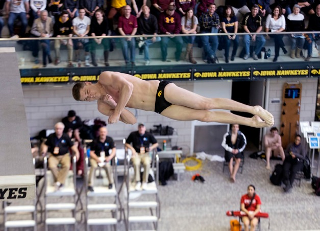 Iowa's Addison Boschult dives from 10 meters as he competes in the platform diving preliminaries during the sixth session of the 2015 Big Ten Men's Swimming and Diving Championships Saturday, Feb. 28, 2015 at the Campus Recreation and Wellness Center on the University of Iowa campus in Iowa City, Iowa.  (Brian Ray/hawkeyesports.com)