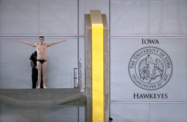 Iowa's Addison Boschult competes on the finals of the platform diving event during the seventh session of the 2015 Big Ten Men's Swimming and Diving Championships Saturday, Feb. 28, 2015 at the Campus Recreation and Wellness Center on the University of Iowa campus in Iowa City, Iowa.  (Brian Ray/hawkeyesports.com)