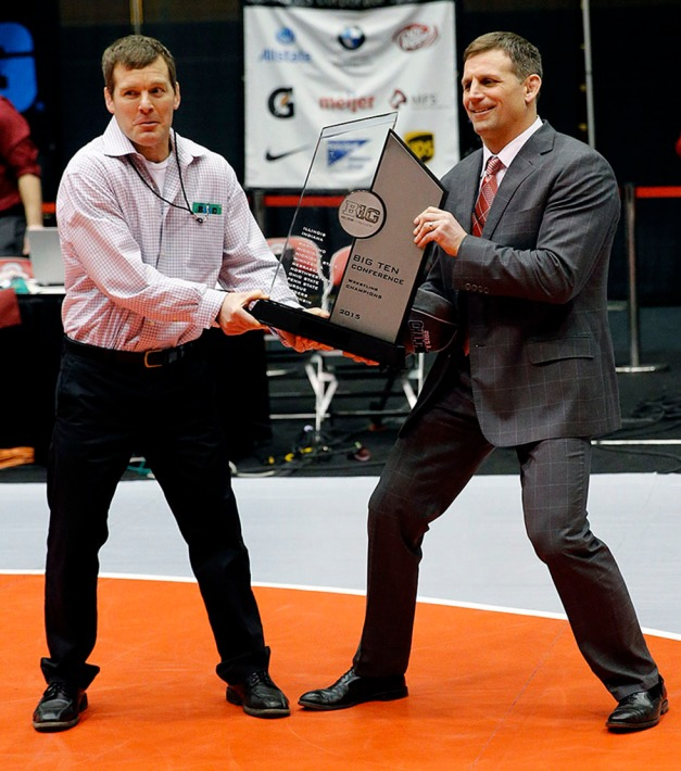 University of Iowa head coach Tom Brands and Ohio State head coach Tom Ryan try to wrestle the team championship trophy from each other after the 2015 Big Ten Conference Championships March 8 in Columbus, Ohio. (Darren Miller/hawkeyesports.com)