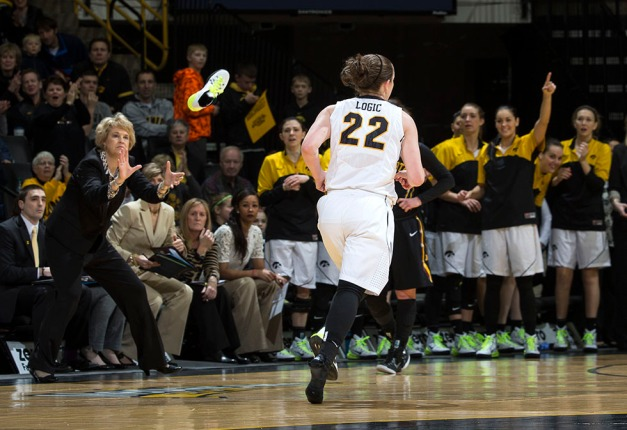 Iowa Hawkeyes guard Samantha Logic (22) tosses her shoe to Iowa Hawkeyes head coach Lisa Bluder as she runs down the court to play defense during the first half of their game against the Minnesota Golden Gophers Sunday, March 1, 2015 at Carver-Hawkeye Arena.  (Brian Ray/hawkeyesports.com)