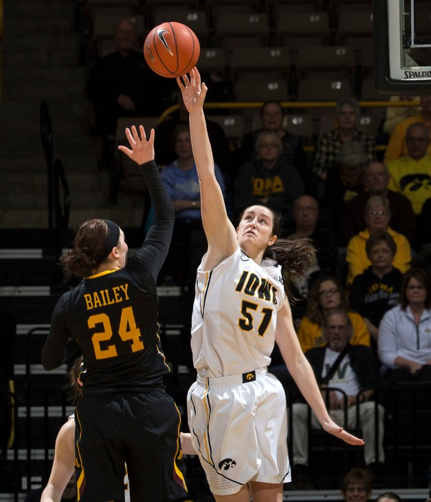 Iowa Hawkeyes center Bethany Doolittle (51) blocks a shot by Minnesota Golden Gophers guard Mikayla Bailey (24) during the first half of their game Sunday, March 1, 2015 at Carver-Hawkeye Arena.  (Brian Ray/hawkeyesports.com)