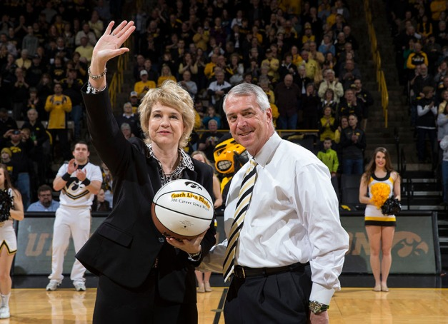 Iowa Hawkeyes Director of Athletics presents Iowa Hawkeyes head coach Lisa Bluder with a ball commemorating her 300th win at Iowa before their game against the Minnesota Golden Gophers Sunday, March 1, 2015 at Carver-Hawkeye Arena.  (Brian Ray/hawkeyesports.com)