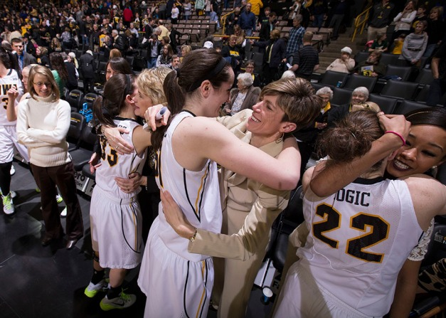 Iowa Hawkeyes center Bethany Doolittle (51) hugs associate head coach Jan Jensen as guard Kathryn Reynolds (33) hugs head coach Lisa Bluder during senior day activities following their win over the Minnesota Golden Gophers Sunday, March 1, 2015 at Carver-Hawkeye Arena.  (Brian Ray/hawkeyesports.com)