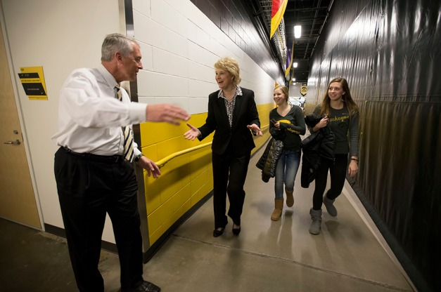 Iowa Director of Athletics Gary Barta congratulates Iowa Hawkeyes head coach Lisa Bluder following their win over the Minnesota Golden Gophers Sunday, March 1, 2015 at Carver-Hawkeye Arena.  (Brian Ray/hawkeyesports.com)