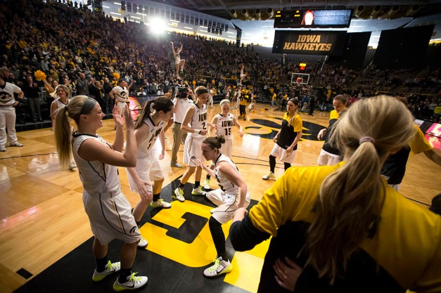 Iowa Hawkeyes guard Samantha Logic (22) slaps hands with center Bethany Doolittle (51) before their game against the Minnesota Golden Gophers Sunday, March 1, 2015 at Carver-Hawkeye Arena.  (Brian Ray/hawkeyesports.com)