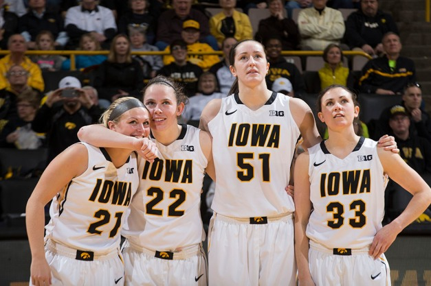 Iowa Hawkeyes seniors Melissa Dixon, Samantha Logic, Bethany Doolittle, and Kathryn Reynolds watch a video package dedicated to them during senior day activities Sunday, March 1, 2015 at Carver-Hawkeye Arena.  (Brian Ray/hawkeyesports.com)