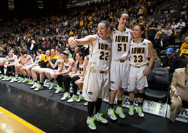 Iowa Hawkeyes seniors Samantha Logic, Bethany Doolittle, and Kathryn Reynolds joke around as they wait for Iowa Hawkeyes guard Melissa Dixon (21) to join them during senior day activities following their win over the Minnesota Golden Gophers Sunday, March 1, 2015 at Carver-Hawkeye Arena.  (Brian Ray/hawkeyesports.com)