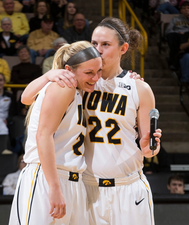 Iowa Hawkeyes guard Samantha Logic (22) kisses guard Melissa Dixon (21) on the head during senior day activities following their win over the Minnesota Golden Gophers Sunday, March 1, 2015 at Carver-Hawkeye Arena.  (Brian Ray/hawkeyesports.com)