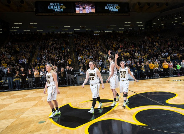 Iowa Hawkeyes seniors Melissa Dixon, Samantha Logic, Bethany Doolittle, and Kathryn Reynolds wave to the fans during senior day activities following their win over the Minnesota Golden Gophers Sunday, March 1, 2015 at Carver-Hawkeye Arena.  (Brian Ray/hawkeyesports.com)
