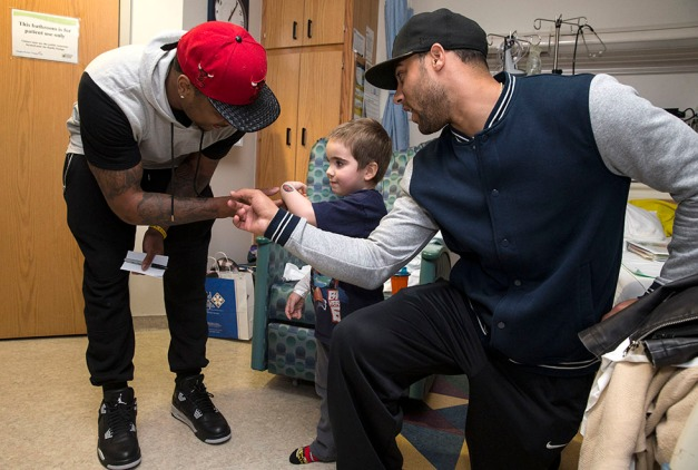 Former Hawkeyes Micah Hyde and Christian Kirksey visit patients at the University of Iowa Children's Hospital Wednesday, March 4, 2015 in Iowa City. Hyde, who plays for the Green Bay Packers, and Kirksey, who plays for the Cleveland Browns, were in town for offseason workouts with Hawkeye Football Strength and Conditioning coach Chris Doyle and wanted to do something to give back to the community.  (Brian Ray/hawkeyesports.com)