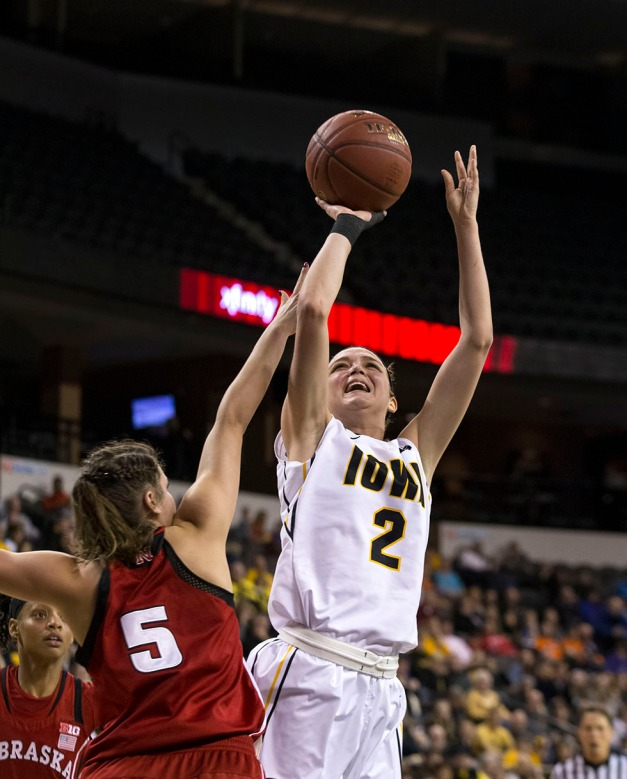 Iowa Hawkeyes guard Ally Disterhoft (2) pulls up for a shot over Nebraska Cornhuskers guard Natalie Romeo (5) during the first half or their game in the quarter finals of the 2015 BIG Ten Tournament Friday, March 6, 2015 at the Sears Centre Arena in Hoffman Estates, Ill.  (Brian Ray/hawkeyesports.com)