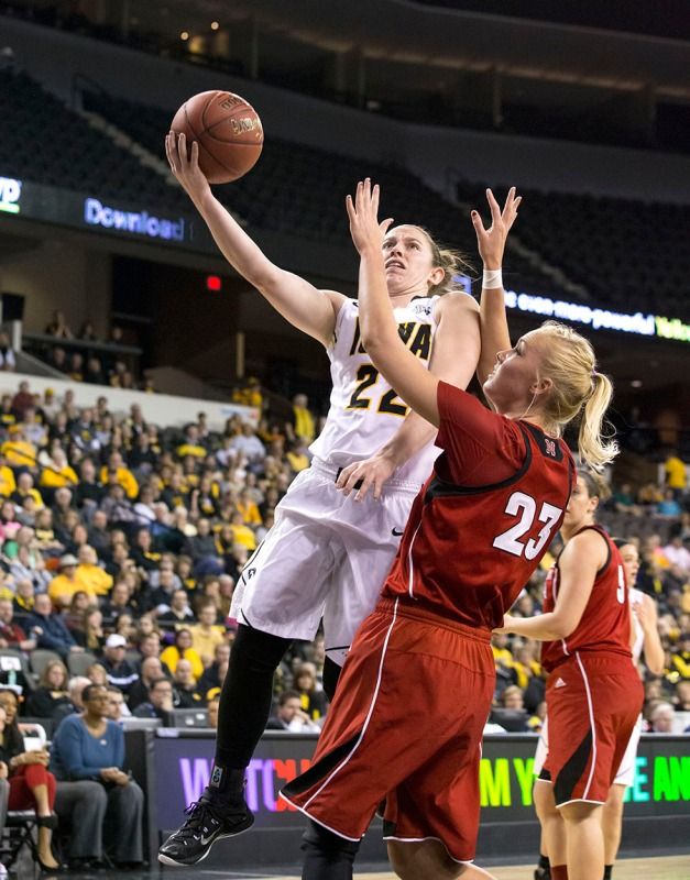 Iowa Hawkeyes guard Samantha Logic (22) goes to the hoop against Nebraska Cornhuskers forward Emily Cady (23) during the first half or their game in the quarter finals of the 2015 BIG Ten Tournament Friday, March 6, 2015 at the Sears Centre Arena in Hoffman Estates, Ill.  (Brian Ray/hawkeyesports.com)